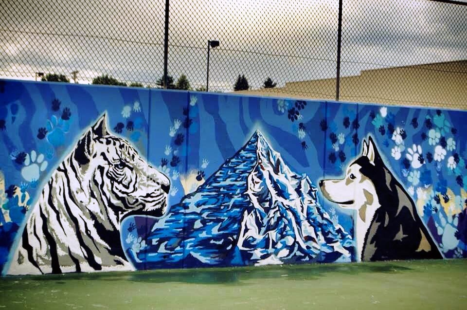 Go to the Untitled (white tiger and wolf viewing each other) page