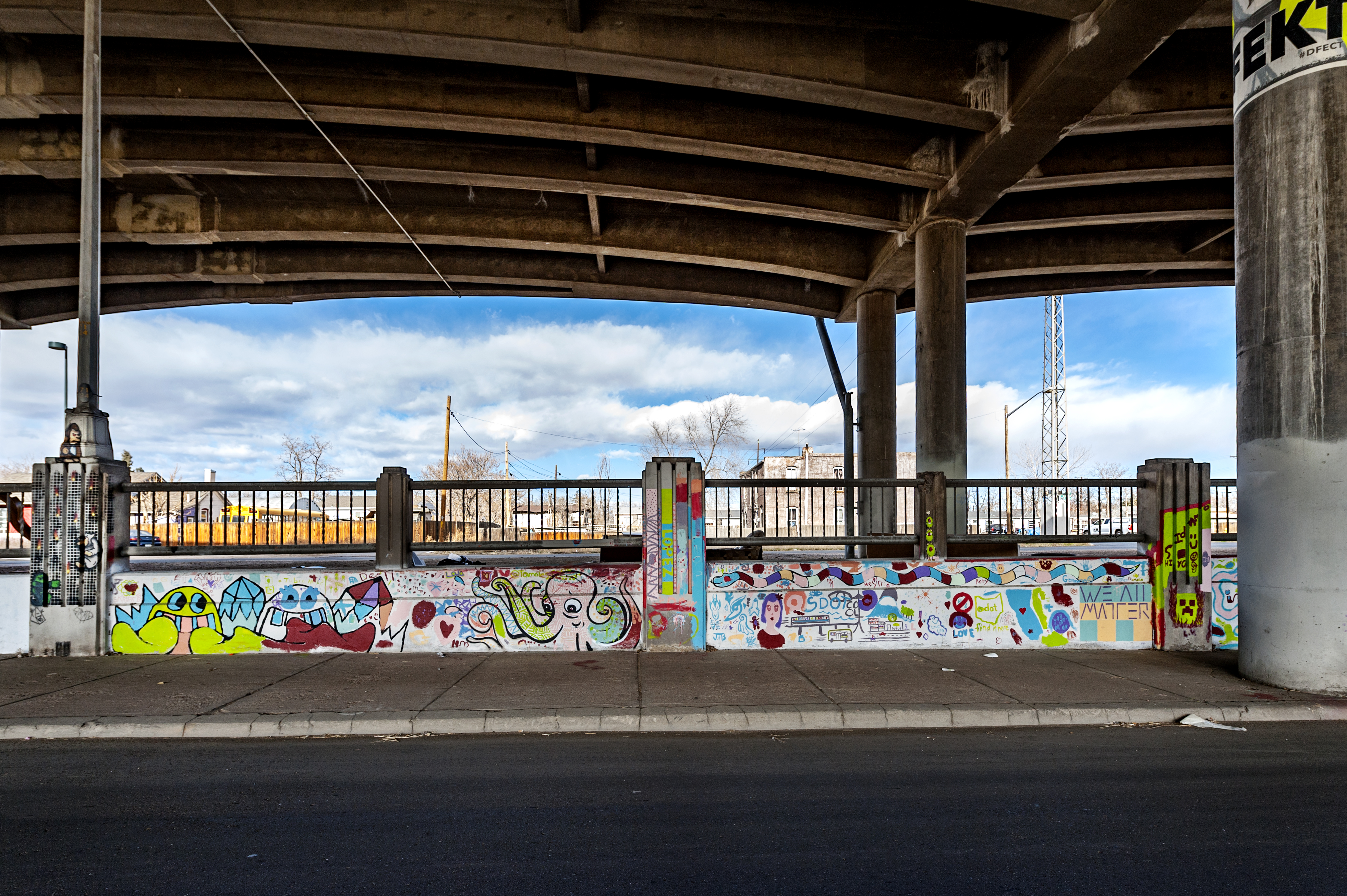 Untitled (colorful mural featuring various whimsical characters and forms)
